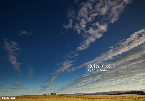 An Infinite sky above a small hut