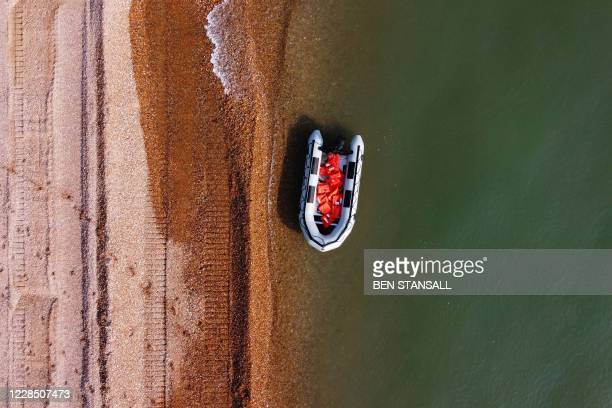 An inflatable boat, used by migrants to cross the Straits of Dover from France to Deal on the south east coast of England on September 14 is pictured...