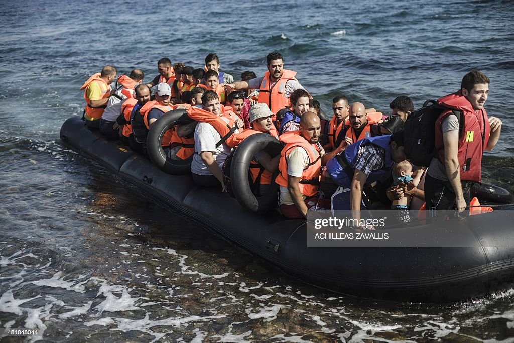 An inflatable boat with Syrian migrants approaches the coast of Lesbos island after crossing the Aegean sea from Turkey, on August 22, 2015. Turkish security forces have detained 435 migrants and Syrian refugees along with three suspected people smugglers, before they embarked on an attempt to cross the Aegean Sea to Greece, reports said. There has been an upsurge this summer in the numbers of refugees and migrants using shaky vessels to make the crossing, sparking a humanitarian crisis for the European Union.
