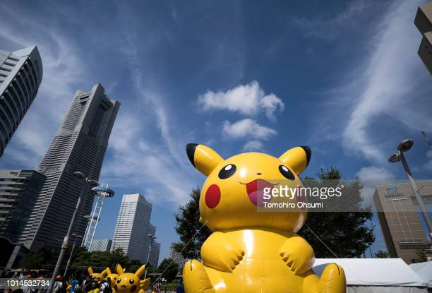 An inflatable bouncer of Pikachu a character from Pokemon series game titles is seen in front of commercial buildings during the Pikachu Outbreak...