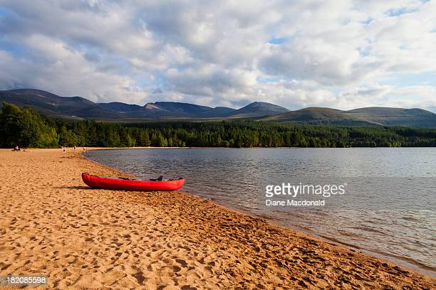 an inflatable canoe on the shore of loch morlich - moored stock pictures, royalty-free photos & images