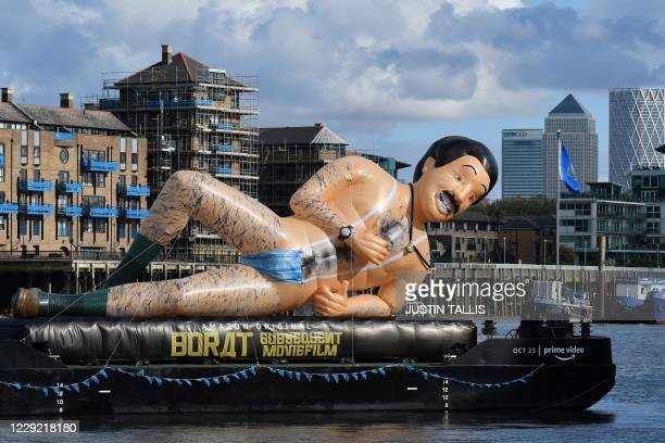 An inflatable in the form of Borat, UK comedian Sacha Baron Cohens fictional Kazakh reporter floats down the River Thames in London to promote the...