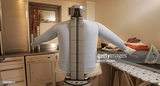 An inflatable ironing machine is seen in the laundry room of the hitech 'Study Home' on June 1 2005 in Sheffield England The Parnell family will...