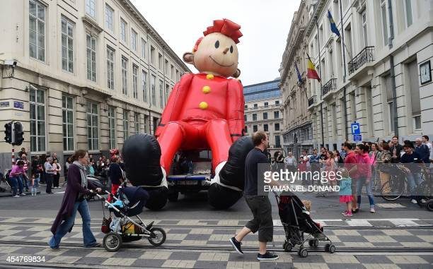 An inflatable of Belgian comics series character Spirou is paraded during the Balloon's Day Parade as part of the annual Comic Book Festival in...