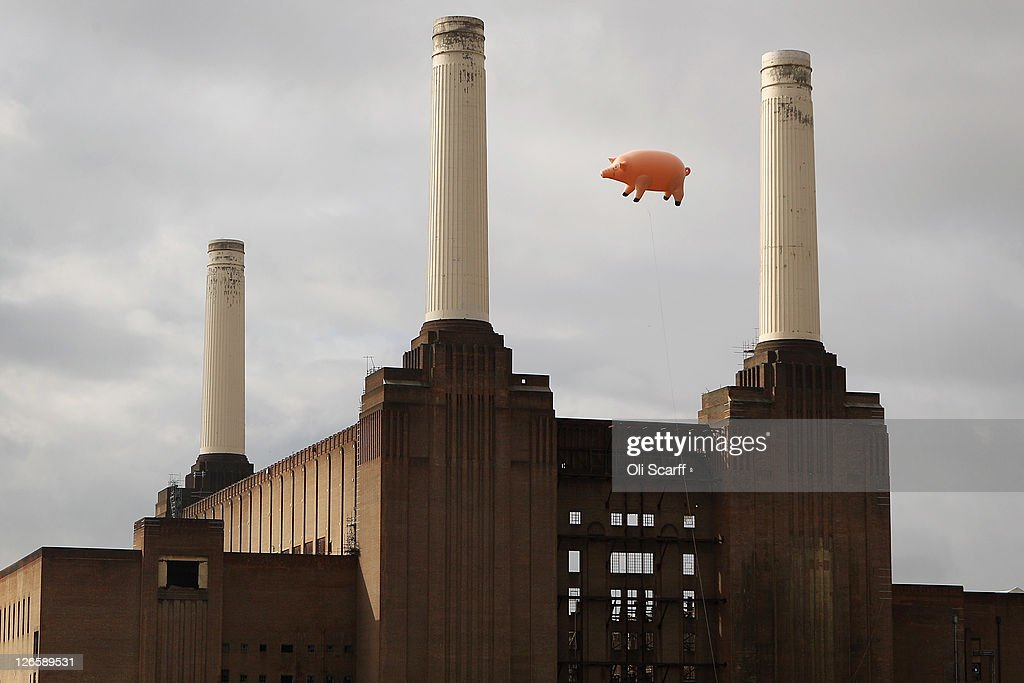An inflatable pig flies above Battersea Power Station in a recreation of Pink Floyd's 'Animals' album cover on September 26, 2011 in London, England. The classic Pink Floyd album artwork was recreated to mark the release of several digitally remastered versions of their albums.