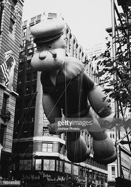 An inflatable Popeye floats over the Macy's Day Parade at Thanksgiving in New York City 26th November 1961