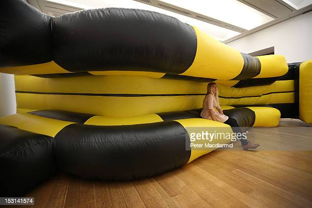 An inflatable slide placed sideways in the gallery forms part of Turner Prize nominee Spartacus Chetwynd's 'Odd Man Out 2011' installation at Tate...