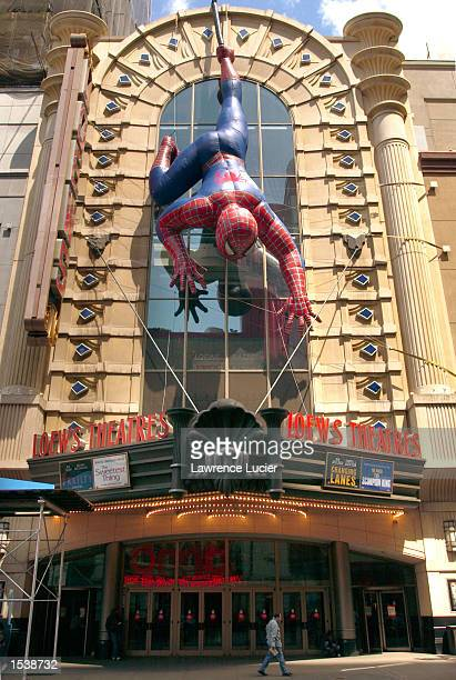 An inflatable Spiderman hangs on the facade of a movie theater April 26 2002 in New York City A film based on the comic book hero debuts May 3 2002