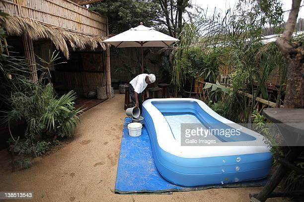 An inflatable swimming pool is filled inside Lebo's Soweto Backpackers on February 6 2012 in Soweto South Africa Lebo Malepa owner of Lebo's Soweto...