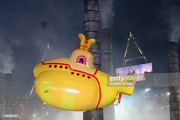 An inflatable yellow submarine floats above artists performing during the opening ceremony of the London 2012 Olympic Games on July 27 2012 at the...