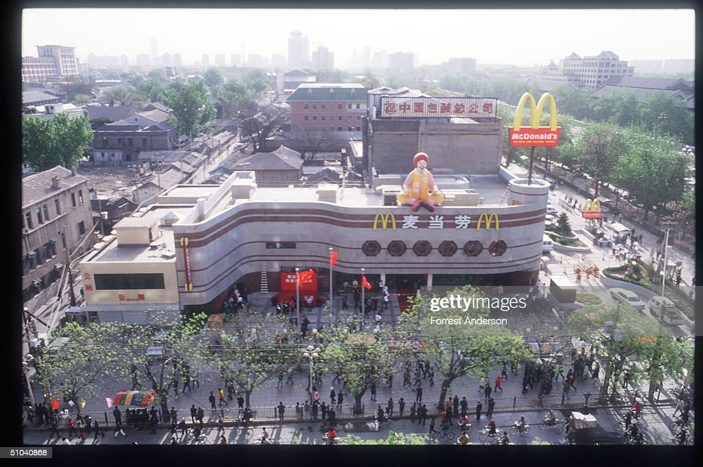 An Inflated Balloon Figure Of Ronald Mcdonald Sits On Top Of China's First Mcdonald's Restaurant April 23, 1992 In Beijing, China. Mcdonald's Opened Its World's Largest Restaurant In The Busiest Shopping District Of The Capital.