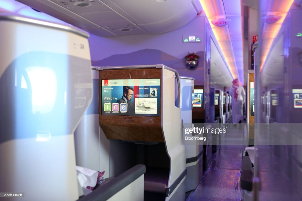 An in-flight entertainment screen sits on seating in the business class cabin of an Airbus SE A380-800 passenger aircraft, operated by Emirates Airlines, during the 15th Dubai Air Show at Dubai World Central (DWC) in Dubai, United Arab Emirates, on Monday, Nov. 13, 2017. The biennial Dubai expo is an important venue for manufacturers to secure deals for their biggest and most expensive jetliners. Photographer: Natalie Naccache/Bloomberg via Getty Images