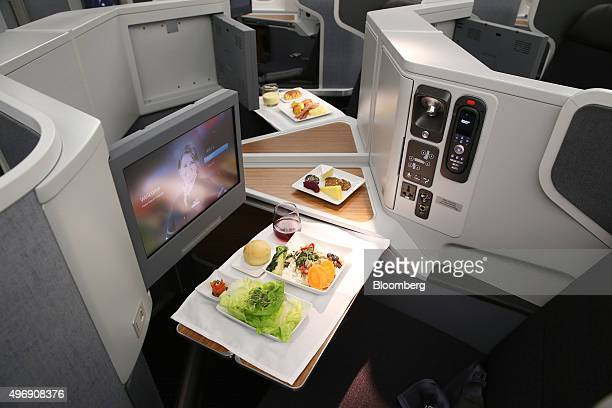 An inflight meal is arranged in a businessclass seat onboard a Boeing Co B777300ER aircraft operated by American Airlines Group Inc at Sydney Airport...