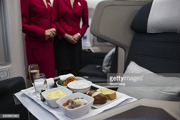 An inflight meal is arranged in a businessclass seat onboard an Airbus Group SE A350900 aircraft operated by Cathay Pacific Airways Ltd during a...
