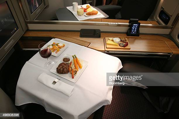 An inflight meal is arranged in a firstclass seat onboard a Boeing Co B777300ER aircraft operated by American Airlines Group Inc at Sydney Airport in...