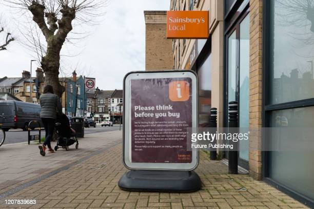 An information about rationing of essential food and household items displayed outside local Sainsbury's shop in Earlsfield in South West London as...