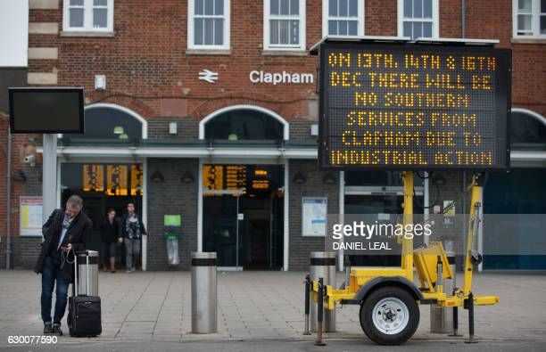 An information banner advises passengers about strike action by Southern Rail outside Clapham Junction station in London on December 16 2016 Hundreds...