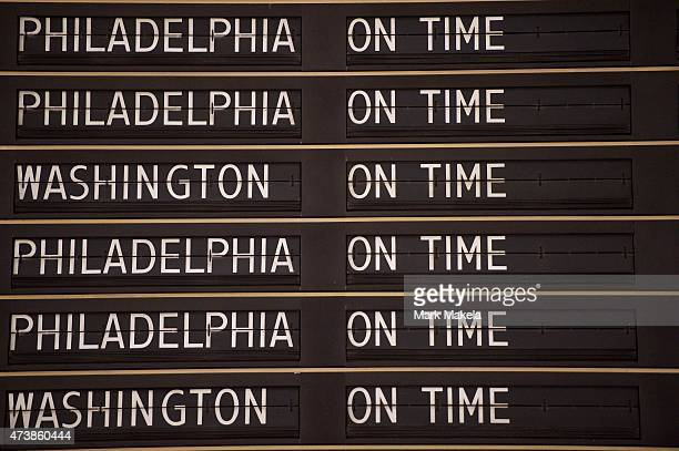 An information board announces the morning train departures as Amtrak resumes northbound service from 30th Street Station with a 553am departing...