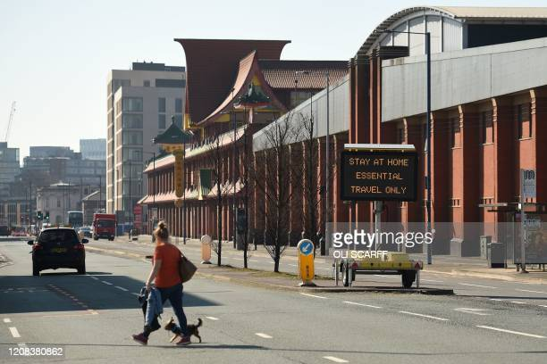 An information board displays a message asking people to stay at home in Manchester northwest England on March 27 2020 Manchester United will refund...