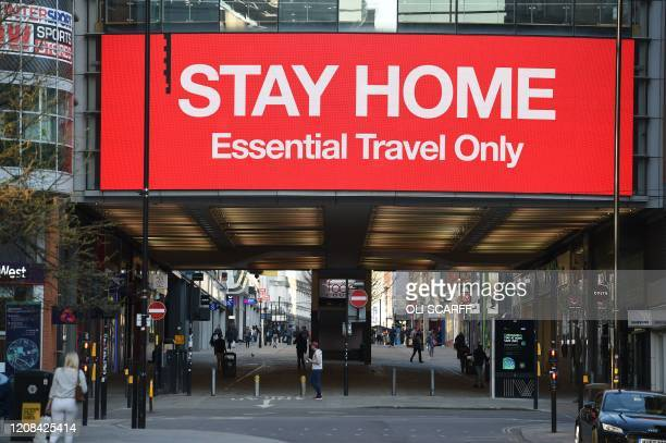 """An information board displays a message asking people to """"stay home"""" in Manchester, north-west England, on March 27, 2020. - Manchester United will..."""
