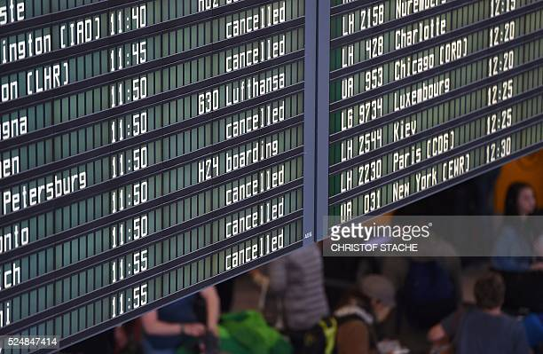 An information board displays cancelled flight at the Lufthansa terminal of the FranzJosefStraussairport in Munich southern Germany on April 27 2016...