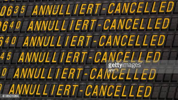 TOPSHOT An information board displays cancelled flights at the airport Stuttgart southern Germany on October 27 2016 380 of 555 flights of budget...
