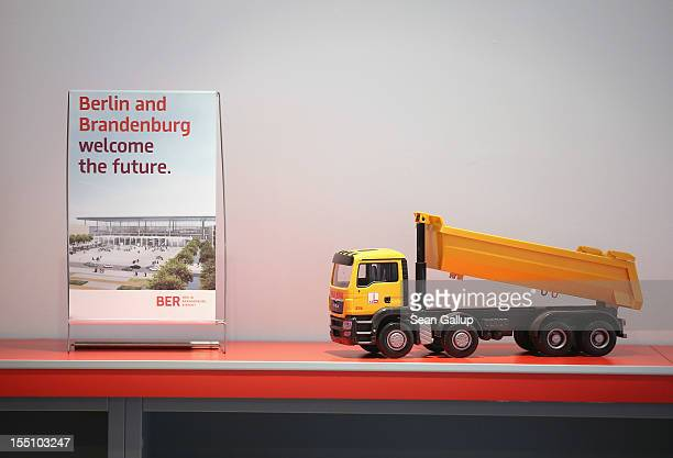 An information brouchre stands next to a toy dump truck in the visitor's center of the construction site of the new Willy Brandt Berlin Brandenburg...