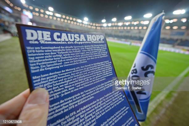An information flyer of the Paderborn supporters concerning banners against Dietmar Hopp is shown prior to the Bundesliga match between SC Paderborn...
