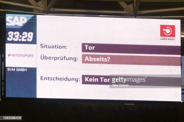 An information from the Video Assistant Referee VAR is shown on the video screen during the Bundesliga match between TSG 1899 Hoffenheim and Borussia...