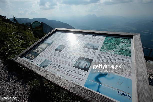 An information plaque for visitors about the Untersberg cave system and their historic circumstances near an underground cave where an explorer is...