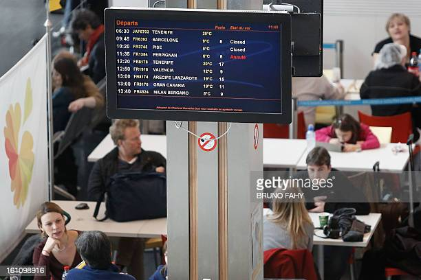 An information screen displays delayed and cancelled flights at the airport after a Cessna passenger plane crashed on February 9 2013 at Brussels...