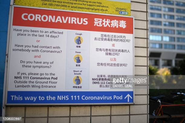 An information sign in English and Chinese explaining ways to identify the Coronavirus, is pictured outside St Thomas' hospital in central London,...