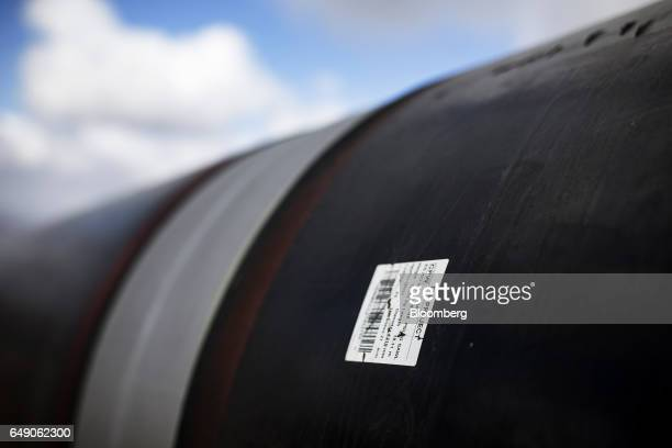 An information sticker sits on the exterior of a pipe section near a welded joint at the 63km point during the construction of the Trans Adriatic gas...