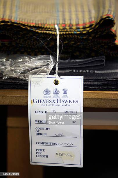 An information tag is seen hanging from a lengh of wool at the Gieves Hawkes store owned by Trinity Ltd on Saville Row in London UK on Tuesday Aug 7...