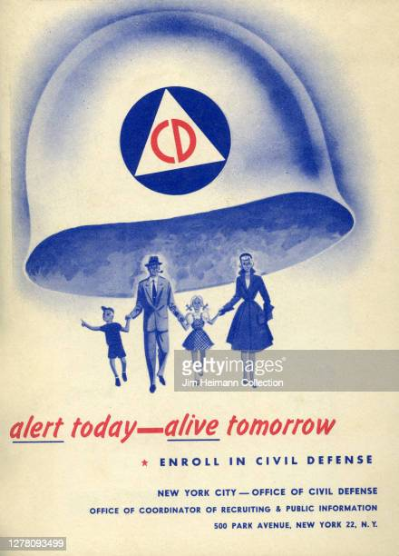 An informational brochure for civil defense shows an illustration of a family walking hand-in-hand beneath a giant helmet, circa 1952.