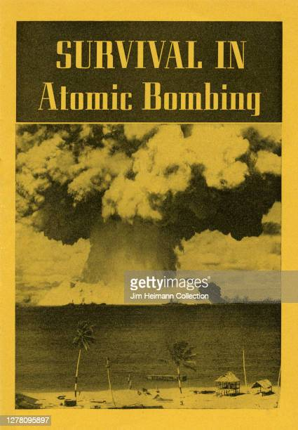 """An informational brochure titled """"Survival in Atomic Bombing"""" shows a black-and-white photo of a mushroom cloud explosion on the water of a sandy..."""