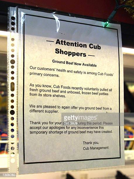 An informational notice regarding replacement ground beef hangs near a food cooler at a Cub Foods grocery store December 4 2000 in Niles IL The...