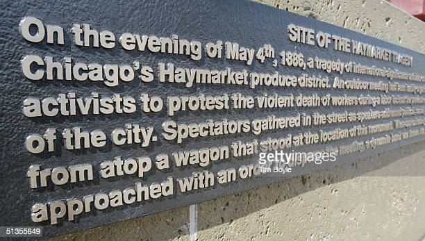 An informational plaque is seen at the Haymarket Memorial is seen September 24 2004 in Chicago Illinois The memorial marks the spot of Haymarket riot...
