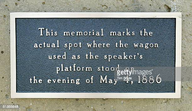 An informational plaque is seen at the Haymarket Memorial September 24 2004 in Chicago Illinois The memorial marks the spot of Haymarket riot of 1886...