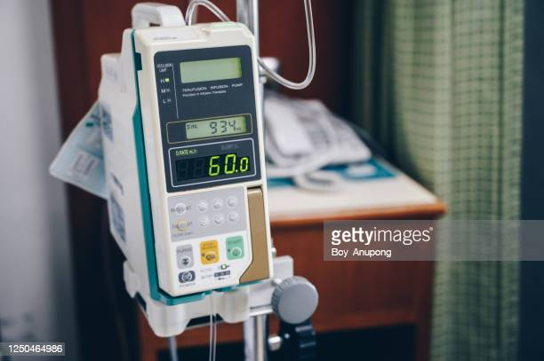 an infusion pump use in clinical settings such as hospitals or nuring home. - infused stock pictures, royalty-free photos & images