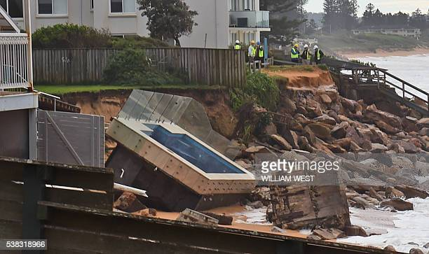 An inground pool sits amongst the rocks after a severe storm at Collaroy on Sydney's northern beaches on June 6 2016 Wild weather which has smashed...