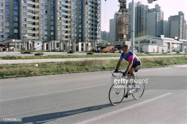 An inhabitant of Serbian capital trains on his bicycle on Ulica Vojvode Putnika at Sarajevo on August 15, 1993. The road leading from the airport to...