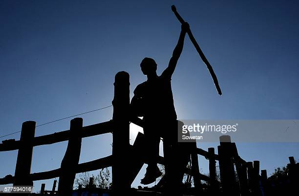 An Initiate is silhouetted during their graduation ceremony at Sebayeng on July 17 2016 in Polokwne South Africa Provincial chairman of the house of...