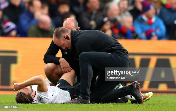 An injured Adam Lallana of Liverpool during the Premier League match between Crystal Palace and Liverpool at Selhurst Park on March 31 2018 in London...