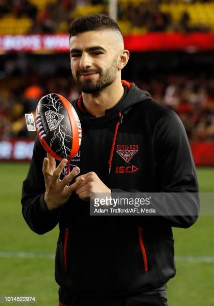 An injured Adam Saad of the Bombers looks on during the 2018 AFL round 21 match between the Essendon Bombers and the St Kilda Saints at Etihad...