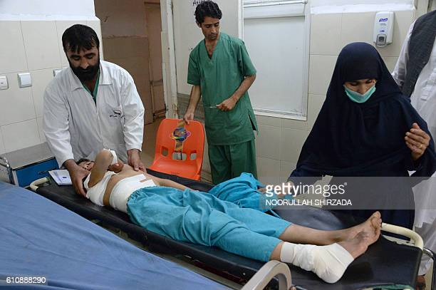 An injured Afghan youth receives treatment at a hospital following a suspected US drone airstrike in the Achin district of Nangarhar province on...