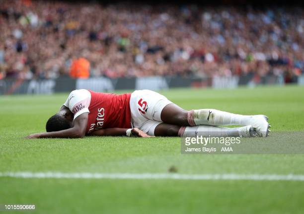 An injured Ainsley MaitlandNiles of Arsenal during the Premier League match between Arsenal FC and Manchester City at Emirates Stadium on August 12...