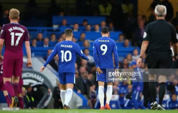 An injured Alvaro Morata of Chelsea leaves the pitch holding his leg during the Premier League match between Chelsea and Manchester City at Stamford...