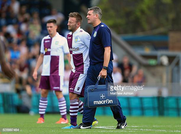 An injured Andreas Weimann of Aston Villa grimaces in pain as he is being substituted