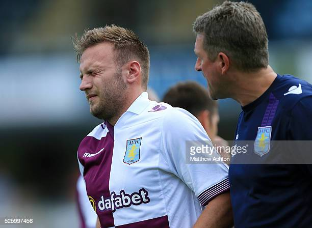 An injured Andreas Weimann of Aston Villa grimaces in pain before being substituted